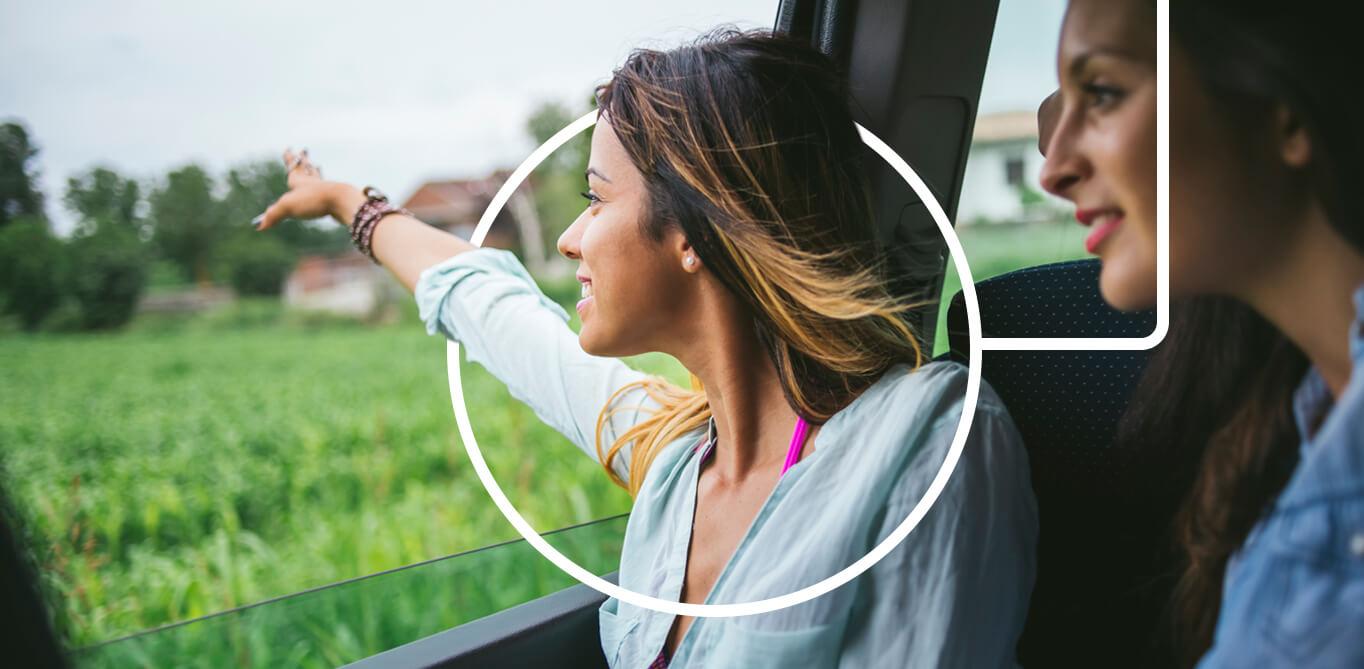 Women looking out car window